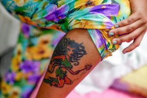 Jessica, 16, who was arrested by the police during a raid at a sex club, shows her tattoo at a shelter for girls who have faced sexual violence or sexual commercial exploitation in Fortaleza November 1, 2013. With Brazil hosting the World Cup next year, officials fear an explosion in child prostitution as sex workers migrate to big cities and pimps recruit more underage prostitutes to meet the demand from local and foreign soccer fans. Picture taken November 1, 2013. To match Feature BRAZIL-PROSTITUTION/ REUTERS/Ricardo Moraes (BRAZIL - Tags: CIVIL UNREST CRIME LAW SOCIETY)