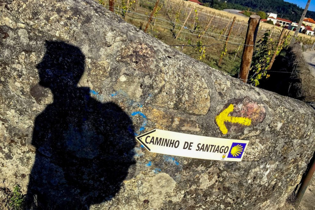 A pilgrim on the route to Santiago. Pilgrimage from Porto in Portugal to Santiago de Compostela , a foot tour of 260 km. This variant is called the Camino Portugu??s.