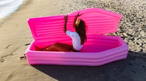Ferrari Press Agency Ref 9416 Coffin1 17/07/2018 See Ferrari text Picture credit: Pom Pom Floats Here?s a dead good way to enjoy the beach this Summer ? in a coffin shaped lilo, complete with closing lid.The float called the Pink Coffin PoolToy, was initially created as a piece of art, in pink, by pom pom floats a collaboration between US designers Andrew Greenbaum and Ian Felton.But the pair were inundated with requests of where it could be bought, they are now raising funds on crowd-funding site Kickstarter to get it into production.The Pom Pom Floats project started three years ago when Greenbaum and Felton decided to create something that was ? fun, nonchalant, satirical, and strange. ?A pledge of $120 USD gets one full-size inflatable pink or black coffin. For $399 USD a limited edition clear or gold version if the company hits its $60,000 USD funding goral.A spokesman said:? Pom Pom wants to create more objects that exhibit this type of work along with collaborations with other artists world wide. ?The Pink Coffin Pool Toy is the first of many doses that Pom Pom plans to unleash onto the world.? OPS: The Pink Coffin Pool Toy Picture supplied by Ferrari.