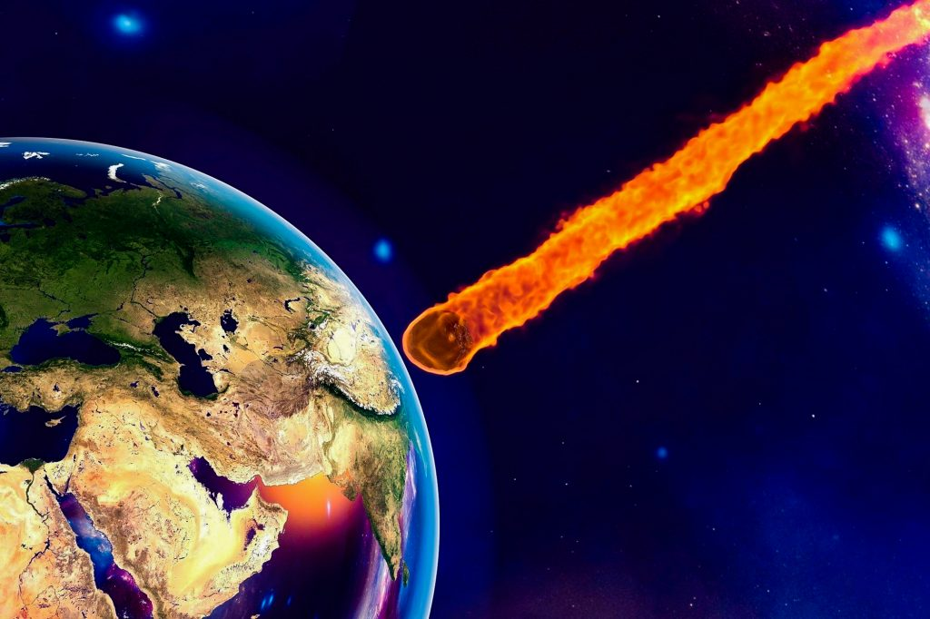 Asteroid approaching to the Earth on background with stars and galaxies, elements of this image furnished by NASA. Space background. Fantastic backgro...