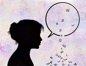 Letters falling from woman's speech bubble