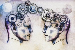Two men's heads face to face connected by cogs