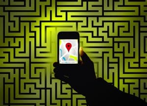 Hand using sat nav to find way in maze