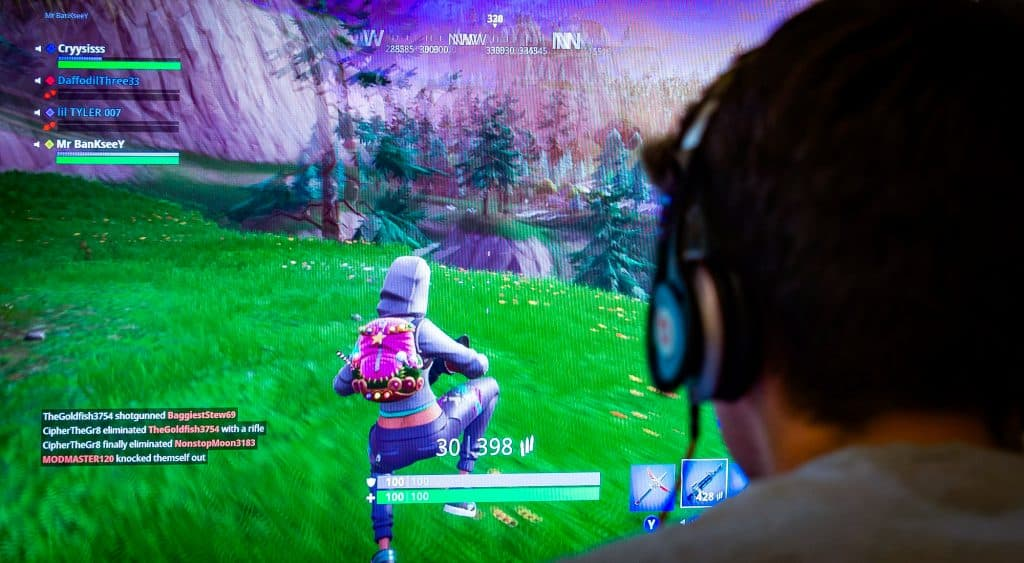 Mandatory Credit: Photo by Steve Meddle/REX/Shutterstock (9722617c) Teenager playing Fortnite video game, Fortnite is a web based multi player survival game developed by Epic Games. Teenager playing Fortnite video game, UK - 13 Jun 2018 fortnite