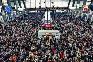 """Passengers wait for their trains during the Spring Festival travel rush, also known as """"Chunyun"""", at the Hangzhou East railway station in Hangzhou city, east China's Zhejiang province, 30 January 2019. China's annual Spring Festival rush - the biggest human migration on the planet - is now officially underway and set to be bigger than ever, with close to 3 billion trips expected to be made between January 21 and March 1. Called """"Chunyun,"""" it's the 40-day period when Chinese people head home to celebrate the Lunar New Year Spring Festival with their families. This year, Lunar New Year falls on February 5. ((Imaginechina/AP/East News)"""